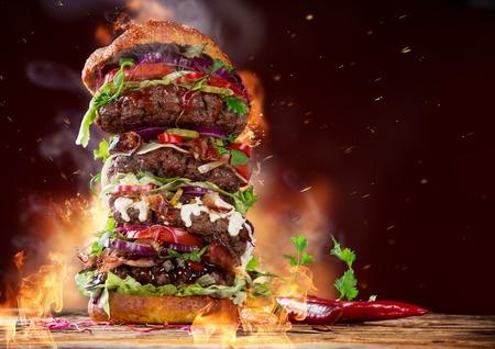 Delicious big burger on dark background