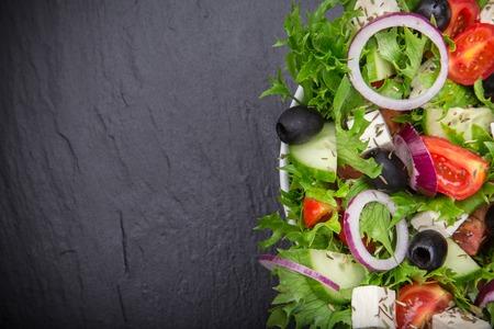 Fresh tasty salad on stone background