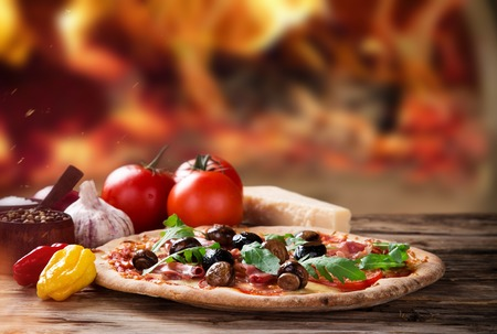 pizza crust: Delicious italian pizza served on wooden table, close-up.