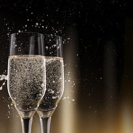 cocktail party: Champagne flutes on black background, celebration theme.