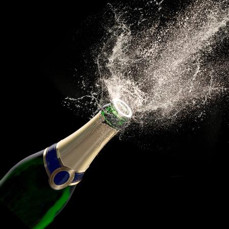 event party festive: Champagne explosion on black background, celebration theme.