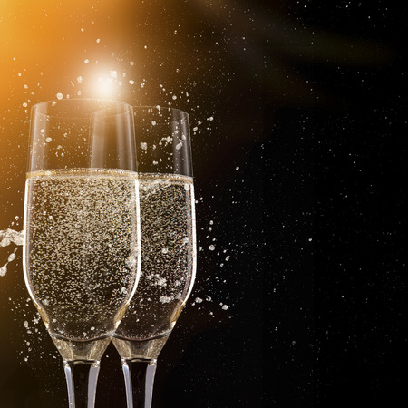 celebrations: Champagne flutes on black background, celebration theme.