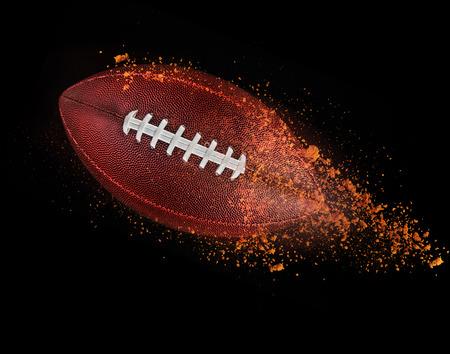pelota de rugby: pelota de rugby volando aislado en negro.