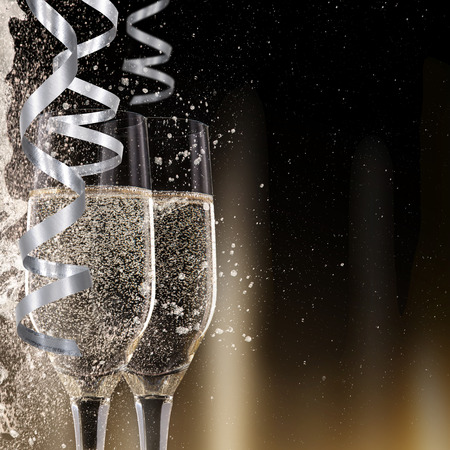 Champagne flutes on black background, celebration theme. Stok Fotoğraf - 34014091
