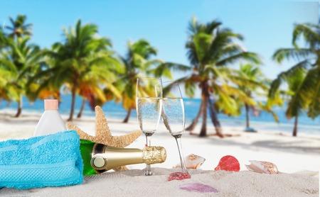 anniversary beach: Champagne bottle on sandy beach