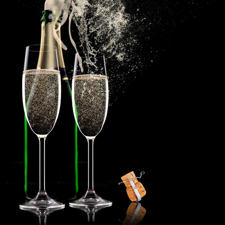 Champagne flutes on black background photo
