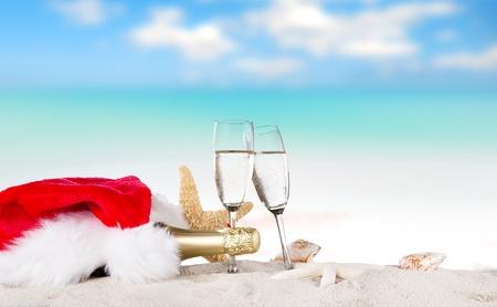 anniversary beach: Champagne flutes on sunny ebach Stock Photo