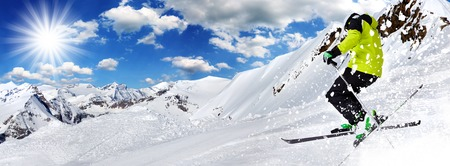 powder snow: Skier in high mountains during sunny day. Stock Photo