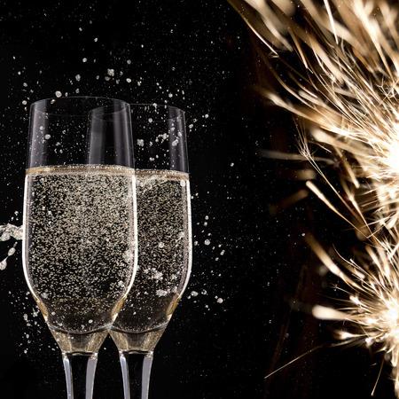 flute: Champagne flutes on black background, celebration theme.
