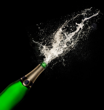 festive occasions: Champagne explosion on black background Stock Photo