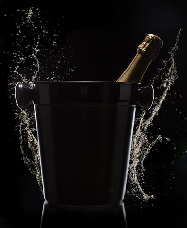 Champagne bucket on black background