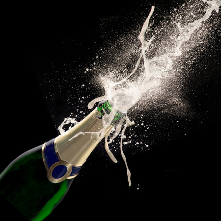 festive occasions: Champagne explosion on black background, celebration theme.
