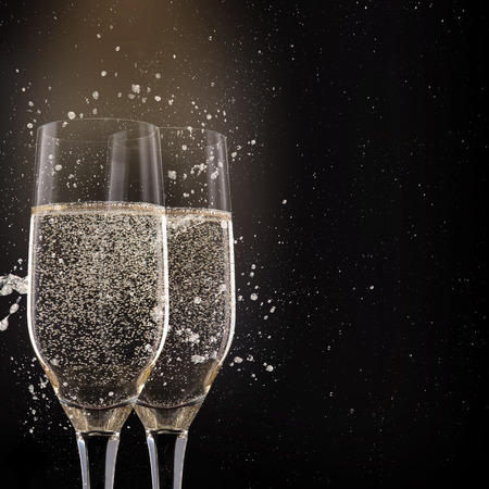 Champagne flutes on black background, celebration theme. Stock Photo - 34392739