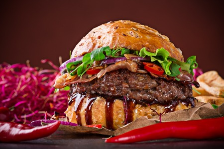 Delicious hamburger on wooden background photo