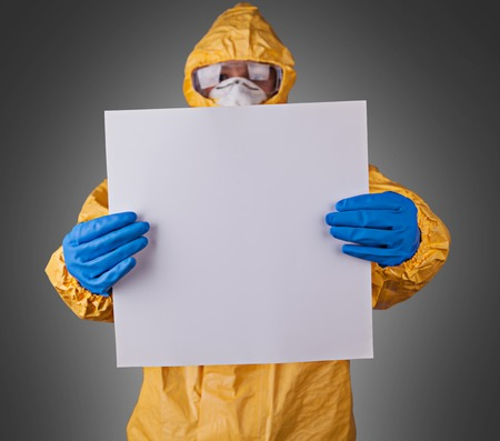 Scientist with protective yellow hazmat suit. Stock Photo