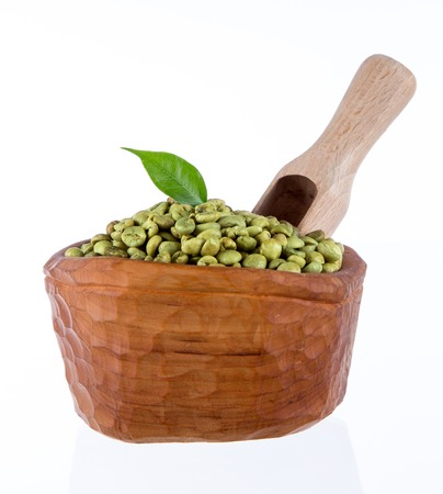 green coffee beans in wooden bowl, close-up. Stock Photo