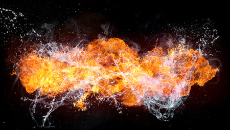 Beautiful stylish fire flames with water splash, close-up. Stock Photo