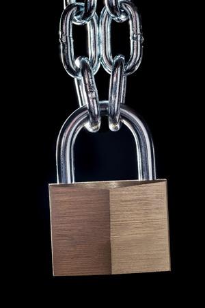 hard love: Metal chain and padlock on black background