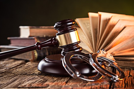 Wooden gavel and books on wooden table, law concept Stock Photo