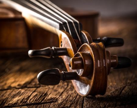 fiddlestick: violin in vintage style on wood background