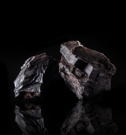 carbon emission: Coal lumps on dark background, close-up Stock Photo
