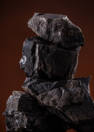 coal fire: Coal lumps on dark background, close-up Stock Photo