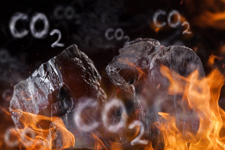 emission: Coal lumps with fire flames, close-up Stock Photo