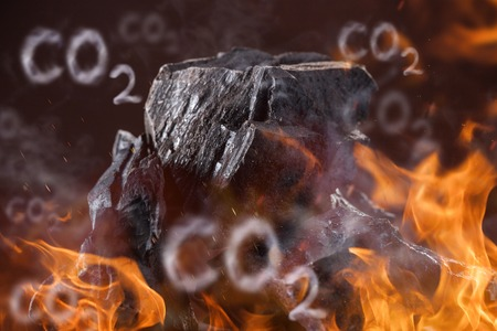 carbon emission: Coal lumps with fire flames on dark