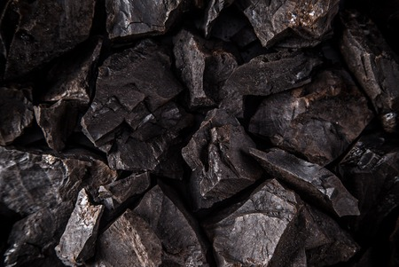 carbon emission: Coal lumps on dark , close-up