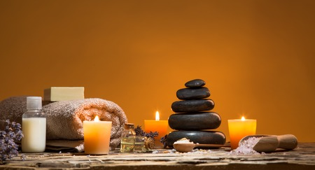 Spa still-life with stacked of stone and burning candles, close-up. Imagens