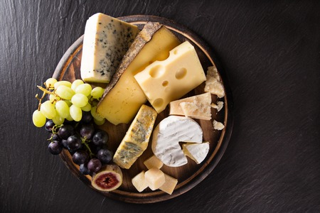 Various types of cheese on stone table, still-life. Stock Photo