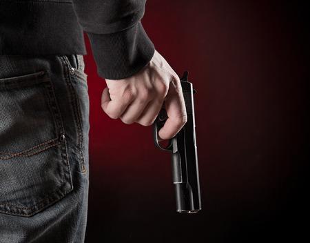 Murderer with handgun
