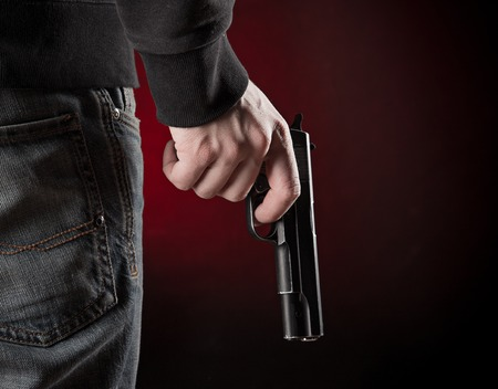 gun fire: Murderer with handgun