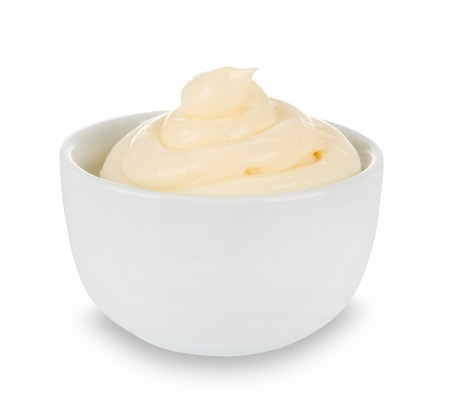 mayo: Mayonnaise in bowl on white background.