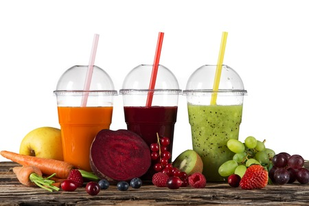 fruit drinks: Fresh juice mix fruit, healthy drinks on wooden table.
