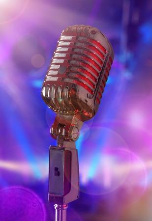 retro microphone: Retro microphone against colourful  Stock Photo