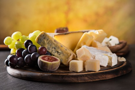 Various types of cheese on stone table, still-life. photo