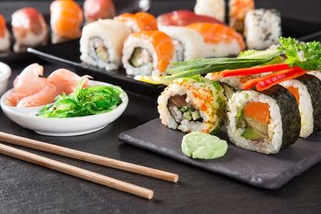 sushi plate: Japanese seafood sushi set on black stone background
