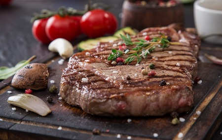 Beef rump steak on black stone table, close-up. Stock Photo - 38612477