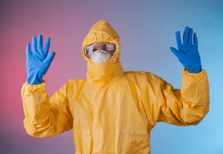 hazmat: Scientist with protective yellow hazmat suit. Stock Photo