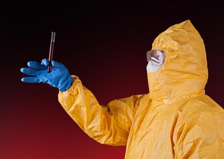 virus protection: Scientist with protective yellow hazmat suit. Stock Photo