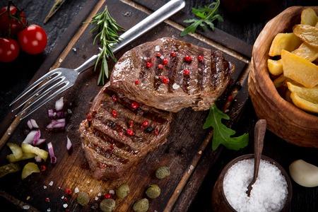 steak beef: Beef steak on black stone table, close-up Stock Photo