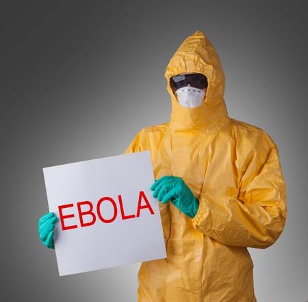 hazmat: Scientist with protective yellow hazmat suit, ebola concept.