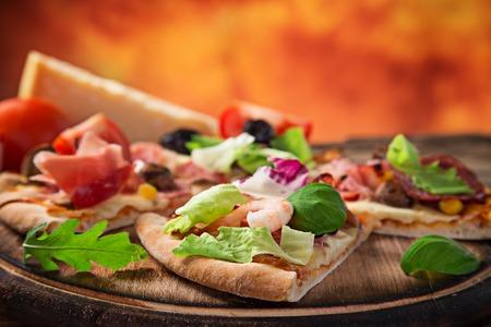 primavera: Delicious italian pizza primavera served on wooden table, close-up.