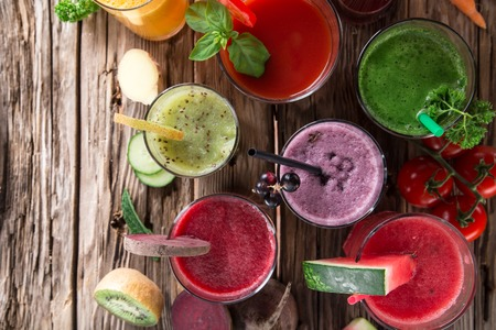 Fresh juice mix fruit, healthy drinks on wooden table. photo