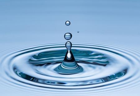 Water drop in freeze motion, macro shot.