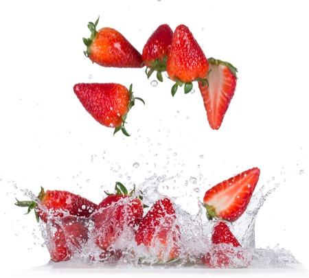 Fresh Strawberries with water splash over white background