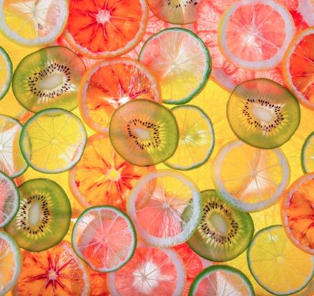Sliced fruits background, close-up. Archivio Fotografico