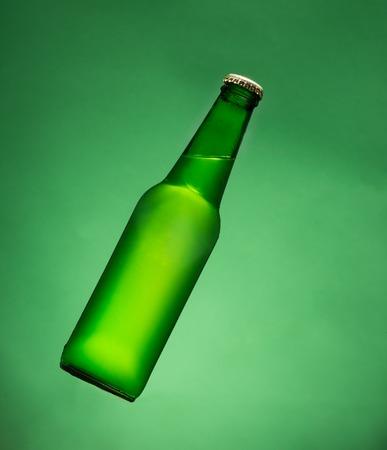 green beer: Green beer bottle in air.
