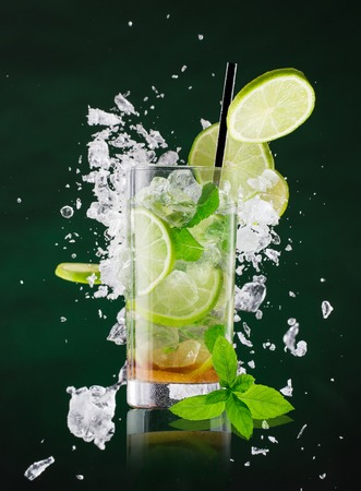 freeze: fresh mojito drink with liquid splash and drift, freeze motion. Stock Photo